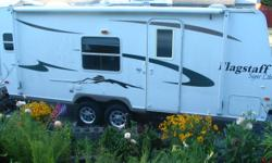 23 ft, queen bed, triple bunks, A/C, stereo/CD player and 2 cable hook ups.  Full kitchen, bathroom with small tub/shower as well as an outdoor shower w/hot and cold water.  Trailer has a GVWR of 6312 lbs (includes up to 2555 lbs of cargo).  Comes with