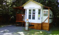 must see too appreciate this very well maintained park model with a custom metal roof,oak laminated floors , insulated 2 inch cedar skirting deck and fencing .this is a one bedroom one bathroom setup for all year living on Vancouver island .a/c propane
