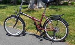 """Adventurer"" folding bike in excellent condition. Fun to ride and great addition for boat or RV. Includes carry bag."