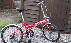 """Campus"" red collapsible/foldable bike. Bought new for over $200, barely used. Comes with a lock. It can be dropped off at your house. $150 or make me an offer."
