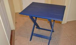 Two solid wood folding tables in excellent condition.  One is painted blue, the other is unpainted.  $15/table  Top Dimension 25 in. wide x 30 in. long