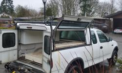 Make Ford Model F-250 Year 1997 Colour White kms 230000 Trans Automatic Ford f250 heavy half tone in good shape no tall gate brand new brakes all around 2500 of o.b.o truck is located in Duncan canopy and rack not included