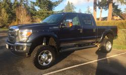 """Make Ford Model F-250 Super Duty Year 2014 Colour Blue kms 56000 Trans Automatic Ford F-250 2014 lifted 7"""" on 35"""" tires 18"""" rims. Custom blue fender flares, chrome side steps, intake, exhaust. Like new condition lots of warranty left. Only needs new tires"""