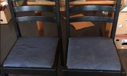 4, straight back solid wooden chairs. painted black (could use painting), blue cushioned seats. Must pick up.
