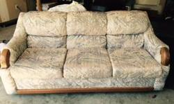 Good condition,clean,solid 3 seat sofa. Tan,cream, blue and brown colors in the fabric on sofa.