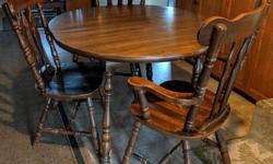 """Table and chairs very solid and well made, some scratches and marks. One captains chair and 4 regular chairs. Table is 46"""" round and comes with 2 leaves. Must pick up"""
