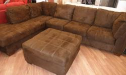 Freedom Cafe Sectional  $665 + taxes All sales are final - Delivery cost extra   Chaise Sectional Comfortable Tufted Seating - Bonus Ottoman It does have some tares on the corner (see picture)   **ALL PRODUCTS LISTED BY EASYHOME-STORE 563 ON KIJIJI.CA ARE