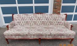 """Used French Provincial chesterfield in good condition. Two very minor hidden stains. Very comfortable. Overall length of 88"""" and overall width of 34""""."""