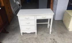 this is a beautiful desk that comes from a non smoking no pets home. the drawers are like new. I can deliver. 250 208 3174 40 x 17 x 30 high