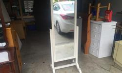 this is a beautiful standing swivel mirror. it comes from a non smoking no pets home. I can deliver. 250 208 3174 25 x 66 high
