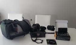 1. Fujifilm XT-1 with 2 lenses : Fujinon XC 50-230mm f/4.5-6.7 OIS and Fujinon XC 16-50mm f/3.5-5.6 OIS (original boxes + manuals) all in mint condition - http://www.fujifilm.ca/products/digital_cameras/x/fujifilm_x_t1/ -
