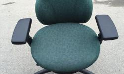 Fully adjustable rolling Office Chairs For sale, $55 each. Excellent condition, including the rollers. Back lumber, tilt, height, arm rests all adjust. All chairs are green. Clean, no stains or wear patterns.