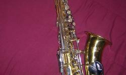 This is a Conn Saxophone that we have had for a number of years and really enjoyed playing with. We arived in Nanaimo a year ago but since the house we moved into is so small we have to let our collection of musical instruments go. I don't know much about