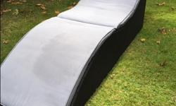 PRICE REDUCTION - Collapsible lawn lounger with cushion. Folds in half for easy storage, also comes with a cover. Diensions: 6' long, 2' wide. Asking $90 OBO