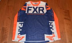 Blue/white/orange FXR Helium Air mx gear. Vented jersey and pants, size medium/30. This gear has only been worn twice, in like new condition. Has name and number on jersey.