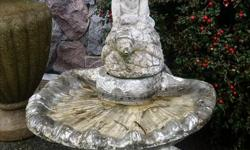 Boy riding a Turtle fountain. Consists of three parts, Base, basin and ornamental fountain. Could be painted or left as is. Has patina from sitting in garden for several years. No pump included.