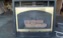26000 BTU's Gas insert fireplace, works great but the fan is a little noisy. Asking 200.00 OBO
