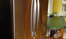 33 inch GE Profile stainless steel refrigerator in very good condition. Only selling because we splurged and bought a Sub Zero.