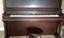 Long string upright piano, recently tuned, beautiful sounding instrument in good condition, comes with claw foot stool