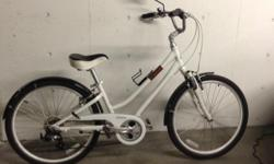 """7 speed city bike, used for only 2 months, Ideal for woman 5'-5'3"""" Adjustable seat and handle bars has strutts"""