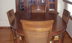 """Oval table, solid cherry wood from Gibbard gallery.  Table measures 42"""" wide, 62"""" long with 2 - 16"""" wide extension pieces.  Hutch is 74"""" high, 60"""" long and 16"""" deep.  There are 6 chairs - solid wood with a cane back, 2 with arms.  Table will sit 8"""