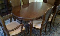 """Absolutely beautiful French Provincial SOLID Cherry Dining Room suite. Complete with 42""""x64"""" dining table plus two additional 16"""" table leaves, 6 cane back chairs including 2 with arms, 20""""x70"""" Buffet AND includes a beautiful area carpet approximately"""