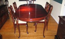 This is a classic Gibbard Mahogany 3 piece dining room set, consisting of table, 6 chairs, Hutch and side board. The dining room table has two additional leafs and can open out to seat 10 comfortably. A heat protection pad is included. The chairs are 4