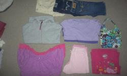 Everything is in excellent condition come from smoke free low scent home. From left to right 1 $30 - 5 shorts, 4 t-shirts, 3 tanks, 1 sweater 2 $20 - 3 skirts, 4 tanks, 2 t-shirts, 1sweater 3 $25 - 3 leggings, 3 tanks, 5 t-shirts, 1 sweater 4 $20 - 3
