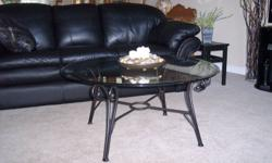 """Glass and dark pewter coffee table 38"""" round x 17.5"""" tall and two end tables 26"""" round x 21.5"""" tall.  Excellent condition.  Asking $250.00."""