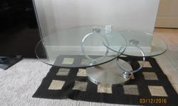 Ring Style. Moveable glass tops on coffee table. 2 end tables.