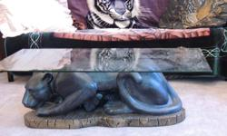beautiful glass top black panther coffee table located in Union Bay