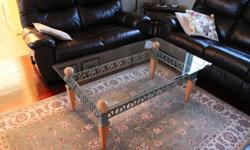 """bevelled edge glass topped coffee table, a few minor scratches. Size 50""""L x 30""""W x 20""""H"""