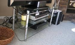 "Custom made Glass with brushed nickel legs TV stand, 3 shelves. 17"" h x 18"" d x 44"" L (28""), very nice. $100.00 OBO"