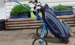 Blue bag on wheels. Clubs include#1,234 Woods. Steel Putter Steels #3,4,6,7,8,9. Golf club covers. Clubs either Spalding or Staff. !2 golf balls