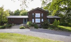 # Bath 2 MLS 973635 # Bed 3 Beautiful 3 bed+den country home moments from Ottawa on premium 25 acre private wooded lot. Stunning exposed wood beams, double sided wood burning FP w/ stone surround. Living rm features cathedral ceilings w/ floor to ceiling
