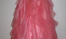 Beautiful grad dress for sale paid over $400.00 only been worn once. Its a size 10 the color is coral pink.