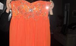 Beautiful orange custom made 2012 grad dress. Brand new, never worn. Fits a size 10-12. I love the dress but I accidently ordered in the wrong size. Originally bought for 150.00. Please contact me at 780-402-1417 if you are interested :)