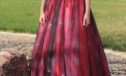 I am offering a beautiful grad dress size 6 with a zip-up back. It is pink with and a tint of black. Asking for $300 or best offer. Worn for two evenings. Practically in new shape.