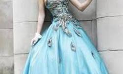Sherri Hill Peacock Grad Dress paid 600.00 worn once size 2 with a lace up back making the size compatible for sizes 2-6