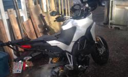 Make Ducati Model Multistrada Year 2010 kms 32000 Akropovic tail pipe, new chain and sprockets, xtra large pannier bags, internal fitted pannier cases, California Science windshield, bazzaz performance controller