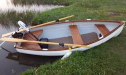 9 foot Victoria manufactured Whitehall rowing tender boat comes with custom fitted Road Runner trailer, excellent tires w/spare, custom made waterproof Sunbrella cover, finished in teak with a set of oars and comes with a 55 lb thrust electric salt water