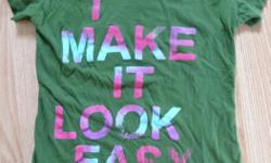 """green short sleeved T-shirt size Womens Extra Small or Teen Girl crew-neck cotton says """"I make it look easy"""" on the front From my pet-free & smoke-free home Willing to Trade if you have something I want/need Discount for buying multiple items"""