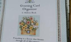 Brand New...  organize your greeting cards for the month in this pocketed book.