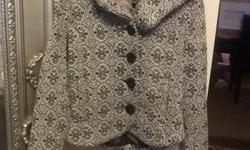 Super cute short jacket. Size medium. Black and white design. Has a great hood and large button closure on front.