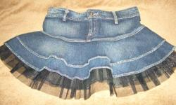 "-Stretch denim with flirty tulle trim -size 27 -Measures about 13"" from waistband to hem"