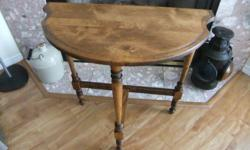"""Beautiful little hall table. This table has just been totally refinished. Solid wood with natural finish lets the beauty of the wood shine through. It measures 24.5"""" high by 11.5"""" deep by 23.3""""wide."""