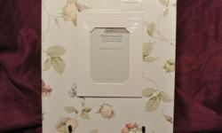 """This is a refillable Hallmark wedding album / binder. It has never been used. It comes in the original box. The book measures: 11 1/2 """" x 10 """". There is a place for a 4 x 6 photo on the front. The pages inside are well organized and beautifully laid out."""