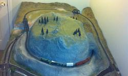 Beautifully hand-crafted N Gage model train set complete with BC landscape layout of mountains and streams! Built on a 3'8 x 7'6 plywood base. See pics to appreciate. Hours of work and materials worth far more than asking price. Call Bob to discuss