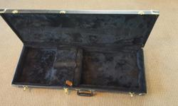 Durable hard shell case in great condition for various electric guitars. Padded and soft interior with small storage area inside.