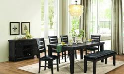 """Large Hardwood dining table with 18"""" hidden butterfly leaf and 4 solid hardwood dining chairs. Add bench or 2 extra chairs for $199. Beautiful dark grey/brown finish. Matching server available for $799. Brand new in box with warranty. Free delivery and"""